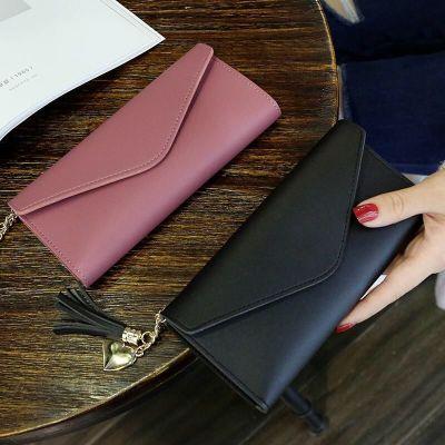 女士錢包女錢包士女長款純三折手機包錢夾軟皮流蘇錢包女學生韓版chongsukei